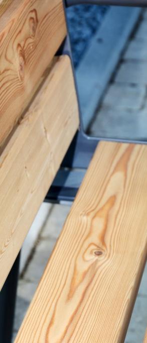 wooden slabs on metal frame bench